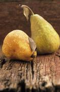 Two pears on a wooden surface - stock photo