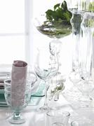 A table laid with glasses - stock photo