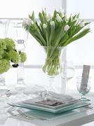A festively laid table with white tulips Stock Photos