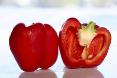 Stock Photo of A whole and a halved red pepper