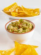Bowl of Guacamole with Chips Stock Photos