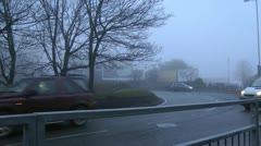 Ambulance with sirens and lights at roundabout in fog Stock Footage