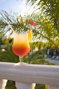 Cocktail on a balcony rail - stock photo