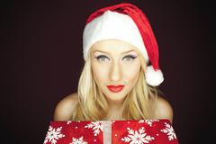 Blonde christmas girl with present Stock Photos