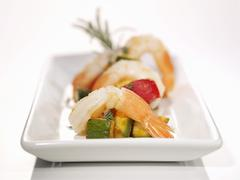 Prawn tails on ratatouille - stock photo
