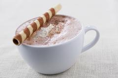 Hot chocolate with wafer roll - stock photo