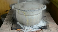 Big pot boil water run flow burn old rural on old rural stove Stock Footage