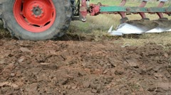 Tractor closeup plow trench furrow agriculture field Stock Footage