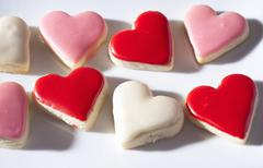Stock Photo of Iced heart-shaped biscuits in rows