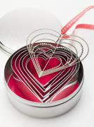 Heart-shaped cutters and hanger with ribbon Stock Photos