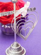 Wire heart with bow, posy of roses Stock Photos