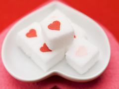 Stock Photo of Sugar cubes with hearts