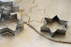 Biscuit dough with star-shaped cutters - stock photo