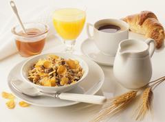 Breakfast: muesli, honey, orange juice, coffee & croissant Stock Photos