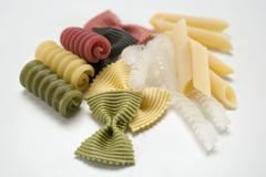 Various types of coloured pasta - stock photo