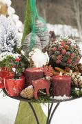 Christmas decorations on table out of doors - stock photo