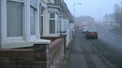 Victorian terrace of houses on a foggy day Stock Footage