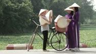 Vietnamese women wearing traditional costume. Hanoi. Vietnam. Stock Footage