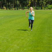 Portrait of a young woman jogging Stock Photos