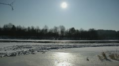 Frozen river neris in winter sunlight and floating floe in water Stock Footage