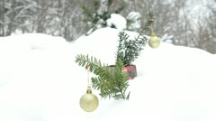 Golden glossy christmas tree toys coniferous branch winter snow Stock Footage