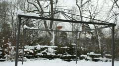 Garden bower arbour construction snow winter wicker basket move Stock Footage