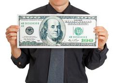 Funny stupid man holding a big money Stock Photos