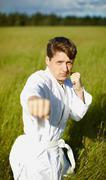 young karateka on nature - stock photo