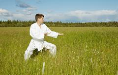 Young karateka trains in open air Stock Photos