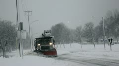 Snow plow during winter storm Stock Footage