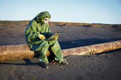 environmental scientist in ecological disaster zone - stock photo
