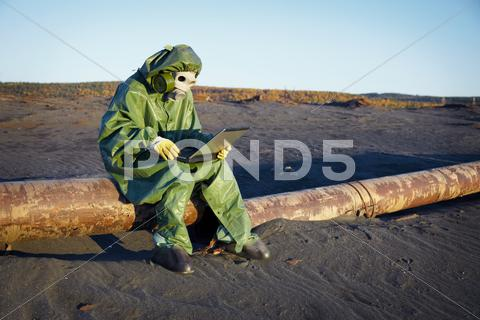Stock photo of environmental scientist in ecological disaster zone