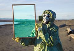 ecologist shows desert through magic framework - stock photo