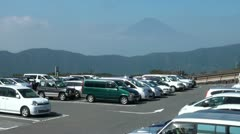 Japanese car park with the famous Mount Fuji in the background Stock Footage
