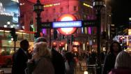 Picadilly circus with lights and underground sign Stock Footage