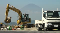 Japanese construction site with Mount Fuji in the background Stock Footage