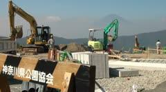 Construction site road work excavators forbidden Mount Fuji Japan nature Stock Footage