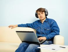 People at home listening to symphonic music Stock Photos
