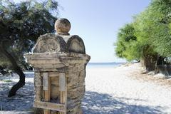 stone column by the sea - stock photo
