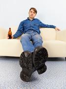 Drunk dude sprawled on couch Stock Photos