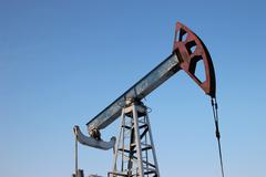 Oil production in the winter. Oil pumps - stock photo
