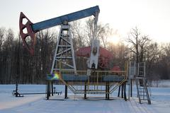 Stock Photo of Oil production in the winter. Oil pumps