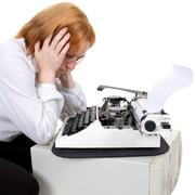 Woman and typewriter Stock Photos