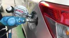 Pumping fuel at a Japanese gas station Stock Footage