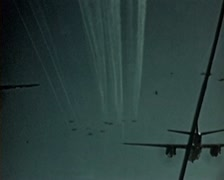WW2 Color Footage - US bomber swarm dropping parachute bombs Stock Footage