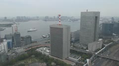 Aerial view of car and train traffic by day,Tokyo, Japan - stock footage