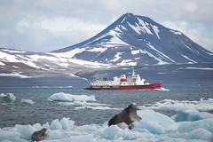 Red ship in the Arctic fjord, Spitsbergen - stock photo