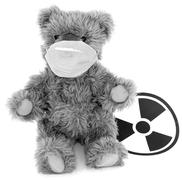 Toy bear and sign to radiation Stock Photos