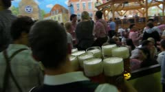 Oktoberfest Germany Munich Beer Festival waiter waitress delivering beer stein Stock Footage