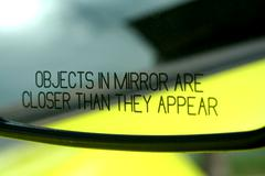 Objects in mirror are closer then they appear Stock Photos
